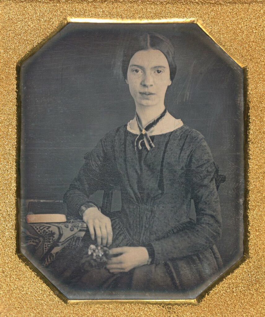 Photo Portrait of Emily Dickinson sitting in a black dress.