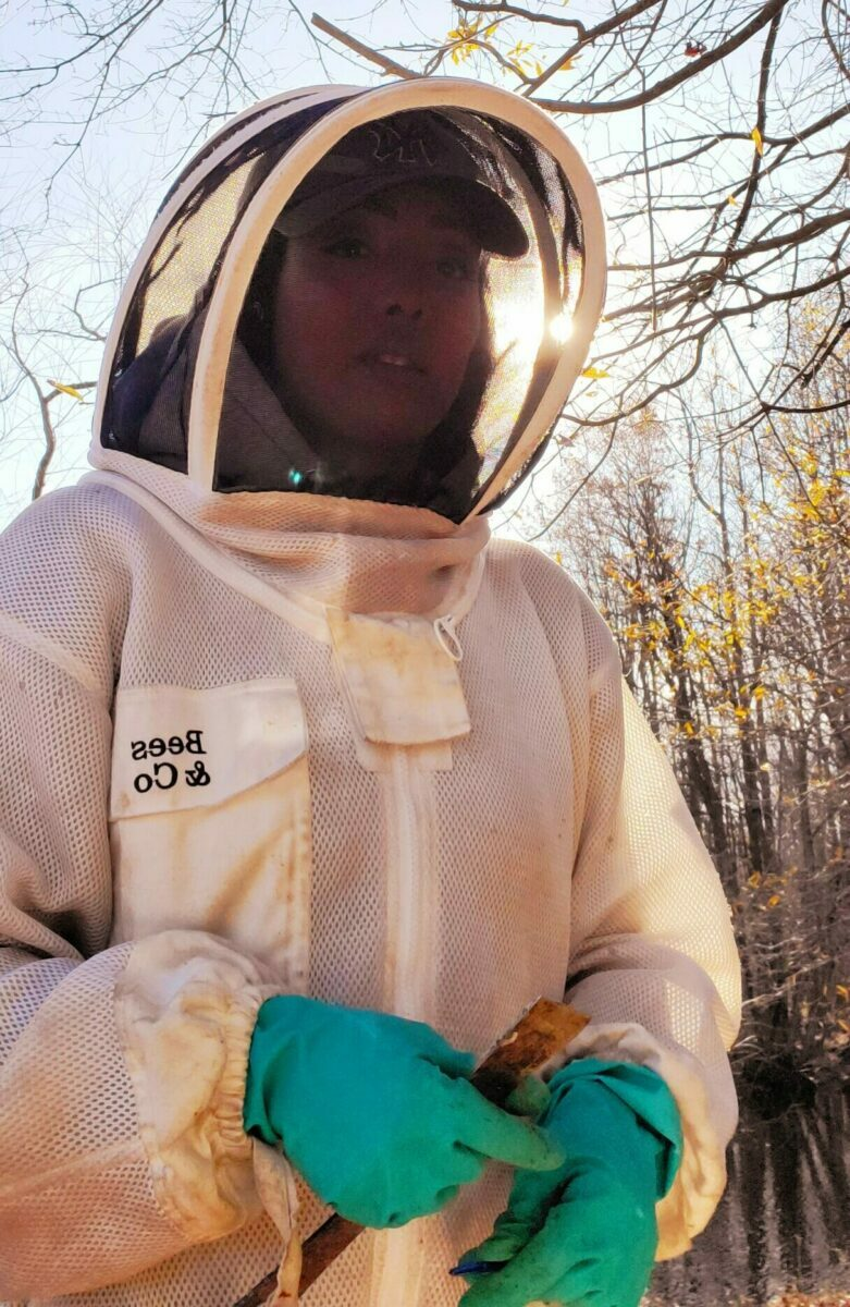 Nicole in her beekeeping suit, ready to save the bees.