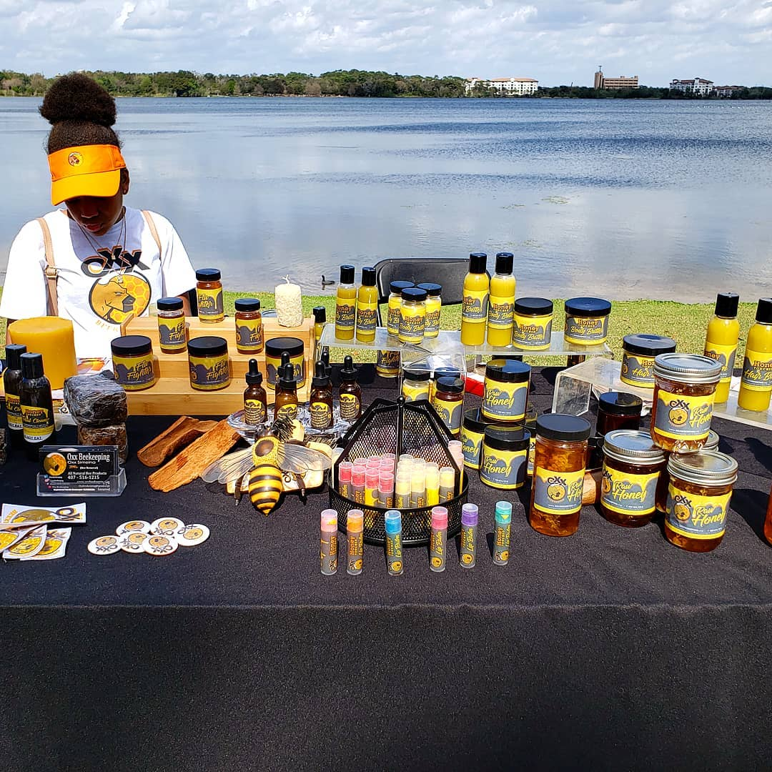 Person at a table selling beehive products