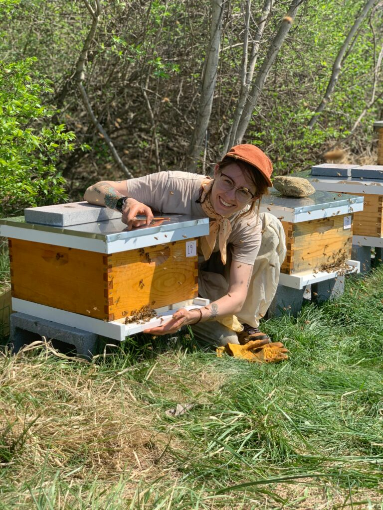 Emily Lawes, Lead Beekeeper for Best Bees' DC Region does their routine hive check.